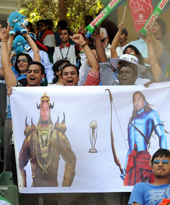 Fans create the <i>Ramayana</i> magic by holding onto a poster which shows Sachin as Lord Rama and Sangakkara as ravaan.