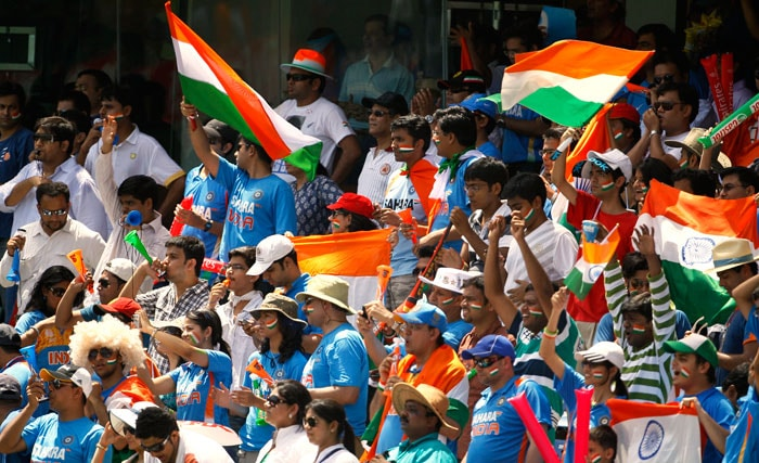 A million fans keep their fingers crossed at the Wankhede Stadium in Mumbai.