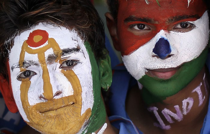 Indian cricket fans have got their faces painted ahead of the ICC World Cup cricket final match between India and Sri Lanka, in Mumbai.