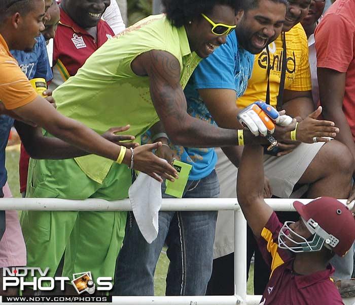 West Indies' Marlon Samuels, below, celebrates with Chris Gayle.