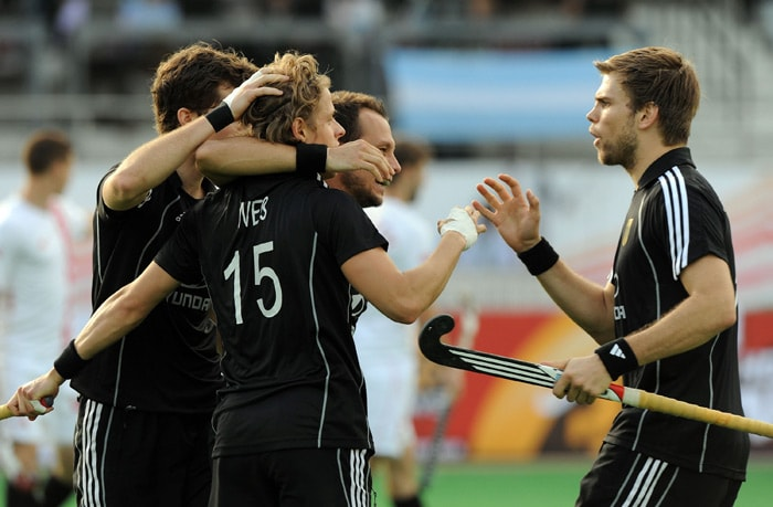 German hockey player Benjamin Wess (2L) celebrates a goal with teammates during their World Cup 2010 match against Canada at The Major Dhyan Chand Stadium in New Delhi. (AFP Photo)