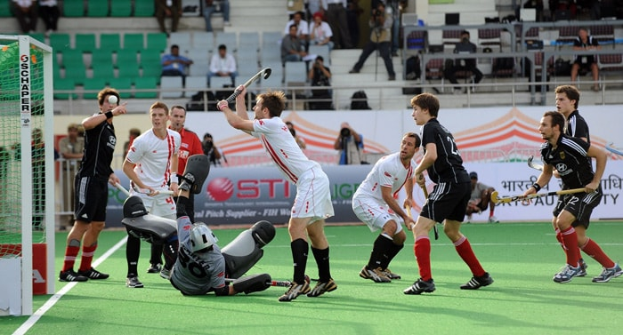 German hockey players Jan-Marco Montag and Matthias Witthaus watch as Canadian hockey players make an unsuccessful attempt to stop a goal during their World Cup 2010 match at the Major Dhyan Chand Stadium in New Delhi. (AFP Photo)