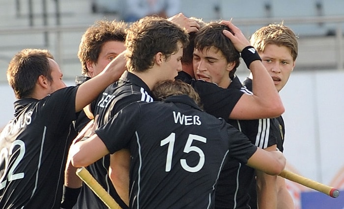 German hockey players celebrate a goal against Canada during their World Cup 2010 match at the Major Dhyan Chand Stadium in New Delhi. (AFP Photo)