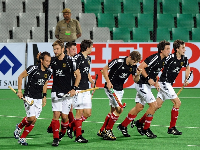 Defending Champions Germany scraped past a plucky Argentina 4-3 in a Pool A hockey World Cup match to brighten their chances for a semifinal berth. (AFP Photo)