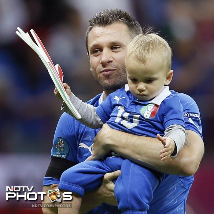 Balotelli's fist goal was set up by Antonio Cassano (seen here with his son) who ghosted through two German defenders and crossed for the striker to beat his marker Holger Badstuber and slam his header past Manuel Neuer.