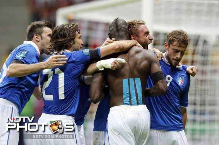 Striker Mario Balotelli struck twice to seal Italy's 2-1 semi-final win over Germany to leave the Germans' Euro 2012 ambitions in tatters while the Azzurri marched on to the final. (All AFP and AP Images)