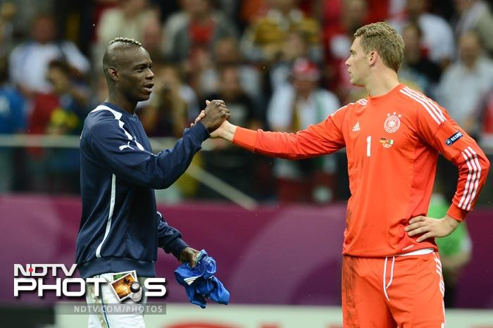 Sportsmanship at its best! Scorer Balotelli shakes hands with Neuer, the man - as Germany's goalkeeper - at the receiving end of those goals.