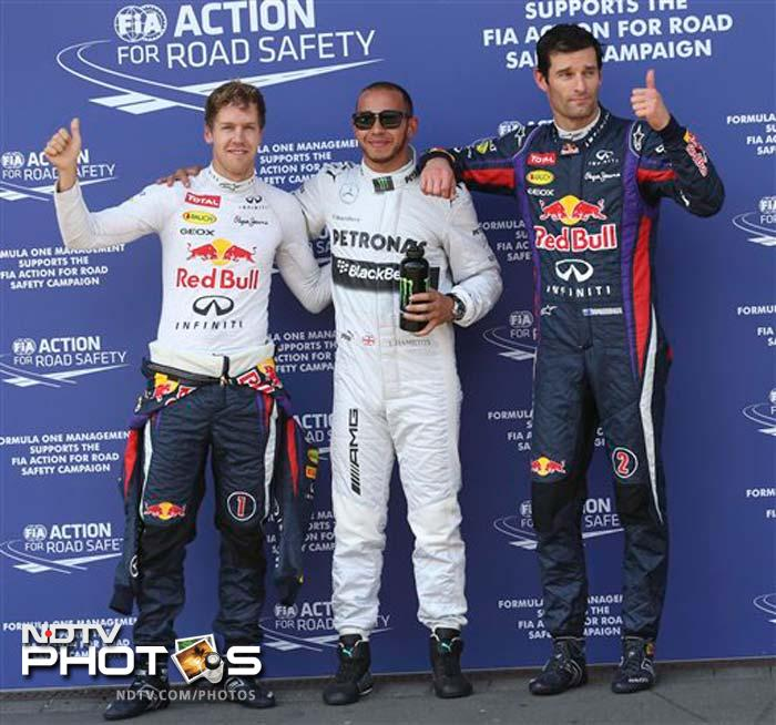 Lewis Hamilton delighted a vast crowd of Mercedes fans when he secured his second pole position in succession with a dramatic fastest lap in the final seconds of qualifying. Red Bull drivers Sebastian Vettel and Mark Webber were second and third.