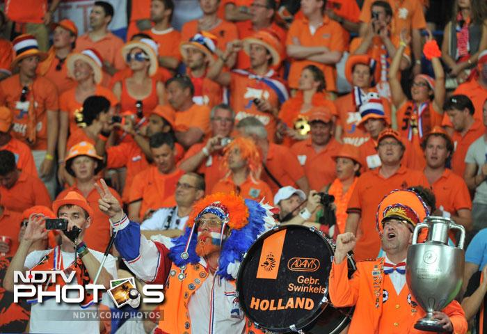 The 'Oranje' fans did come out in numbers in expectation. But they were not obliged by their heroes as Netherlands slumped to a 2-1 defeat. (AFP Photo)