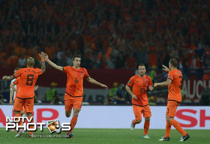 But it eventually was van Persie that gave the Dutch a sniff of a chance scoring a fine goal. It came too late though as Germany crushed Netherlands' hopes. A miracle is what is needed for the Oranje now to qualify for the next stage. (AFP Photo)