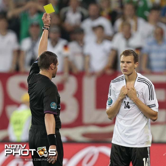 With the Portuguese turning up the pressure, Holger Badstuber was booked for a foul on Manchester United's Nani with halftime approaching.