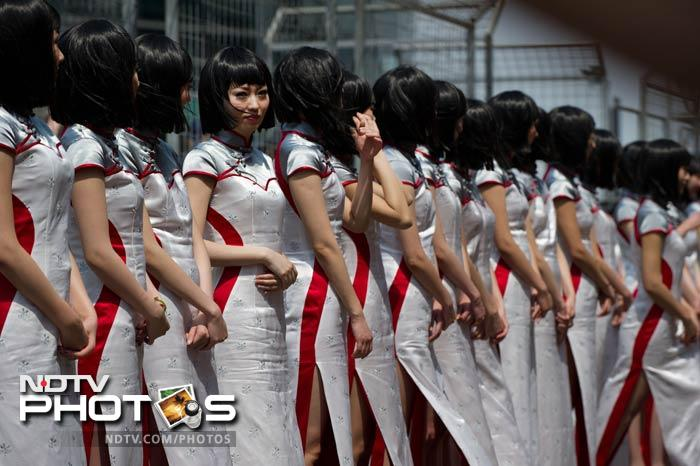 The grid girls though were their confident best at the Shanghai circuit ahead of the F1 race. (AFP image)