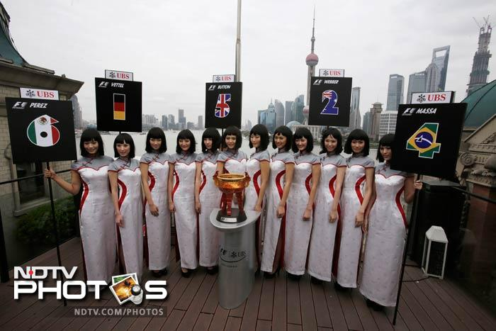 Chinese pit girls have been well known for the poise with which they carry themselves. For the 2013 edition of the race in Shanghai, they were dressed in traditional attires and yet struck a very suave and modern blend. A look. (AP image)