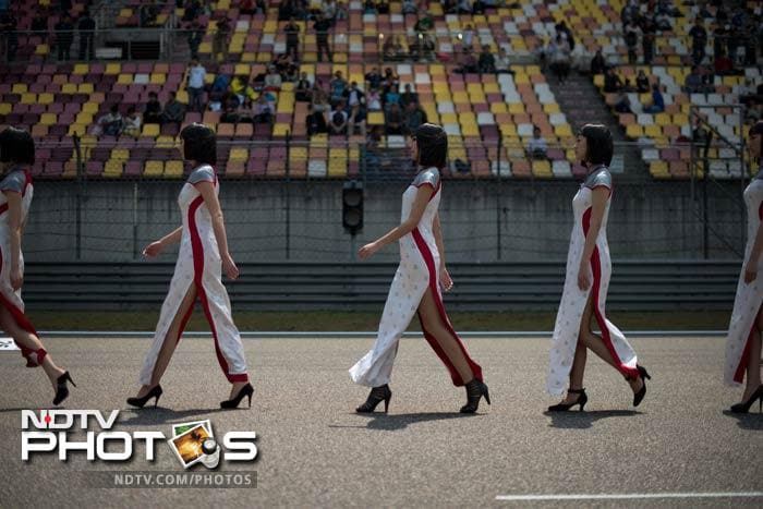 According to several media reports in the run-up to the race, the grid girls were specially chosen after a careful screening process. (AFP image)