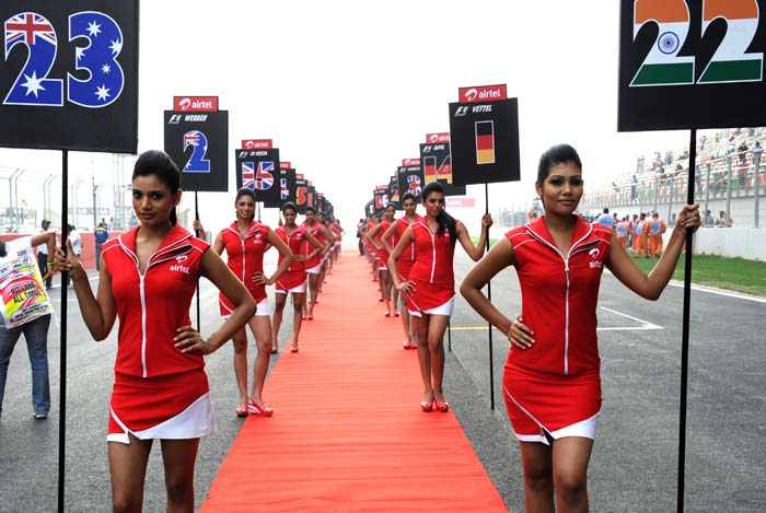 Grid girls get set to take the track before the inaugural Indian Grand Prix.