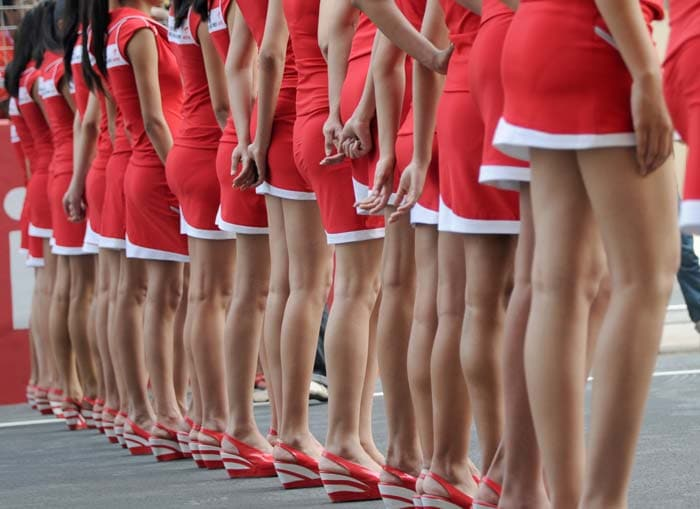 The grid girls line up before the start of the race.