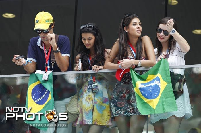 Some of the fans could give stiff competition to the grid girls and models here though. Fans of Felipe Massa are seen here though they couldn't be after his accident in the race.