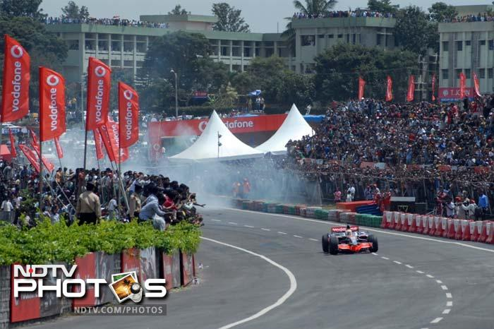 Lewis Hamilton set Bangalore up in smokes. Literally. Then again, when one of the fastest man on land comes calling, speed, velocity and sheer thrill of an F1 car is a given. Click on for more. (Agency images)