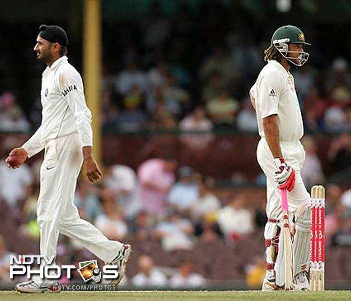 2008: Gets embroiled in another big controversy in January as he is charged with racially abusing Australian all-rounder Andrew Symonds after being involved in an altercation with him during the 3rd day of the 2nd Test at Sydney Cricket Ground. Is banned for 3 matches by match referee Mike Procter after a hearing following the conclusion of the Test. However, the harsh penalty despite the lack of sufficient evidence draws the ire of the Indian camp and they threaten to withdraw from the series. An appeal hearing is conducted after the fourth Test in Adelaide and Harbhajan is cleared of racial abuse as the charge is not proved. The 3 match ban is revoked but the spinner is fined 50% of his match fees for using abusive language.<br><br> Harbhajan's run-ins however don't end here and he gets into a bigger mess after slapping his Indian team-mate Sreesanth during a match between Mumbai Indians and Kings XI Punjab in the Indian Premier league. The Mumbai player had apparently been ticked-off by Sreesanth's aggressive sending-off of his batsmen as Punjab cruised to a victory. He is banned from the IP for the rest of the season. (Getty Images)