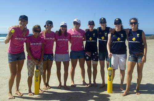 Australian surfers and cricketers pose for photos at a beach cricket game. (Cricket Australia)