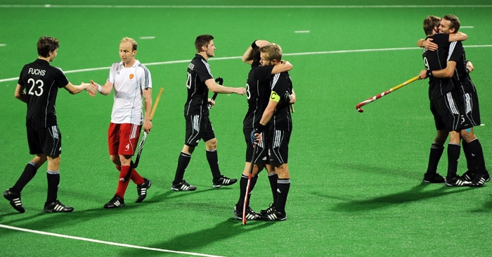 German hockey players celebrate after beating England during their World Cup 2010 semifinal match at the Major Dhyan Chand Stadium in New Delhi. (AFP Photo)
