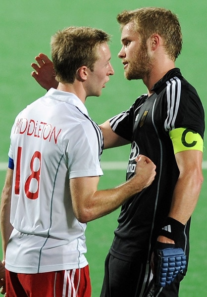 England's hockey captain Barry Middleton (L) gestures to German hockey captain Maximilian Muller (R) during their World Cup 2010 semifinal match at the Major Dhyan Chand Stadium in New Delhi. (AFP Photo)