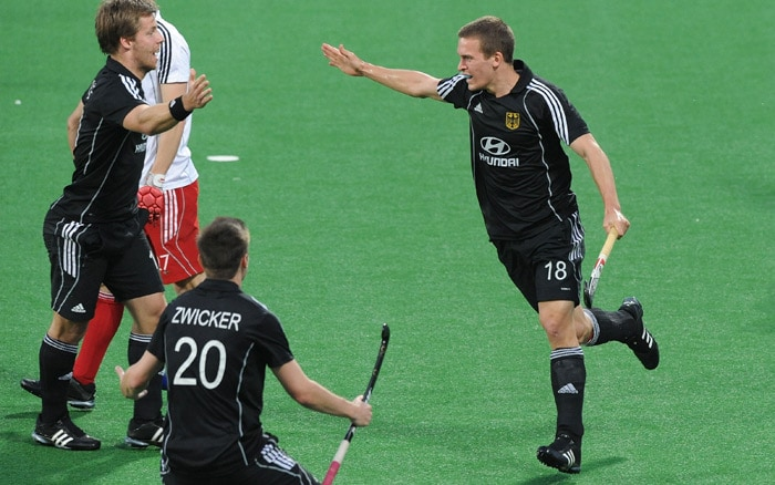 German hockey player Oliver Korn (R) celebrates his team's second goal during their World Cup 2010 semifinal match at the Major Dhyan Chand Stadium in New Delhi. (AFP Photo)