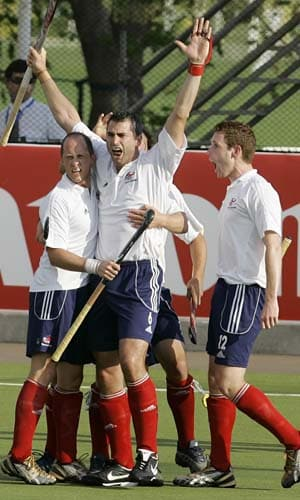 Great Britain's Richard Mantell (centre) celebrates with team-mates after scoring against India in the final game of hockey Olympic qualifiers in Santiago on Sunday.