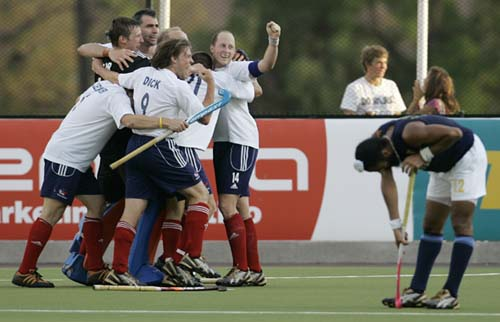 Great Britain's players celebrate their 2-0 victory over India with team-mates after scoring against India in the final game of hockey Olympic qualifiers in Santiago on Sunday.