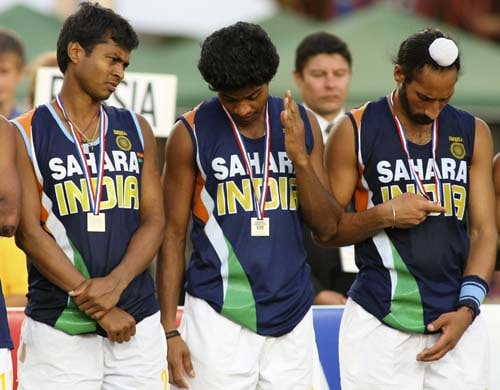 India's players (from left) Dilip Tirkey, V.R. Raghunath and Rajpal Singh wear their medals after losing to England the field hockey final qualifying match for the Beijing 2008 Olympic Games in Santiago on Sunday.