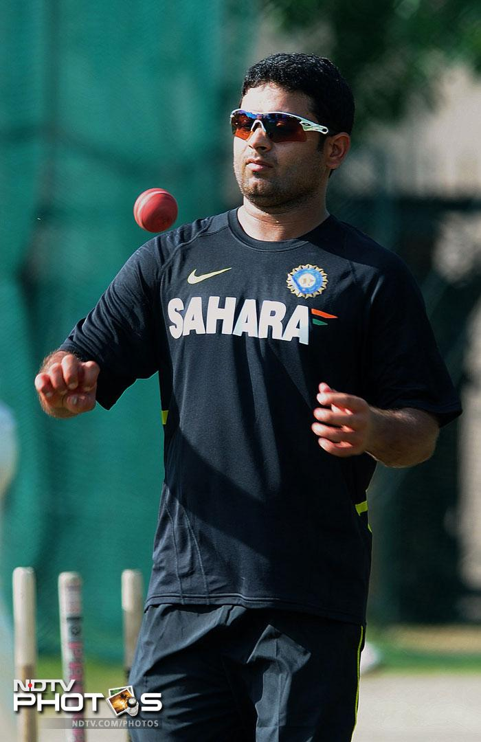 Piyush Chawla gears up to bowl at India's training session ahead of the first Test against New Zealand.