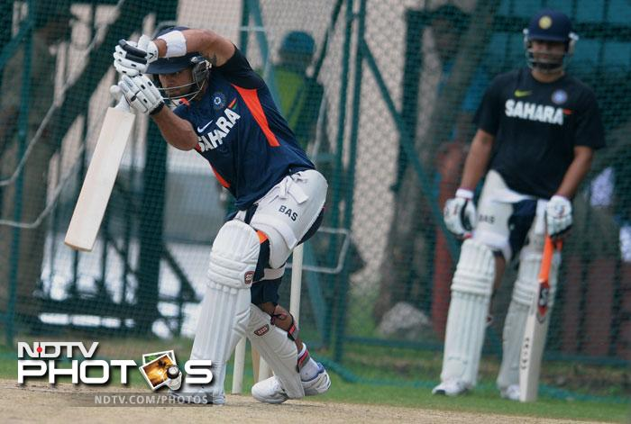 Virat Kohli practices one of his drives as he has a go at the nets.