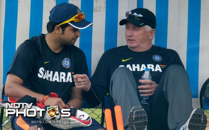 Suresh Raina discusses a point with Duncan Fletcher as he takes a break from training.