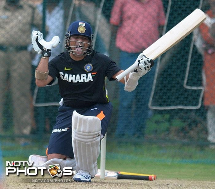 Sachin Tendulkar gesturing during a net session as he prepares for the first Test against New Zealand at Hyderabad.