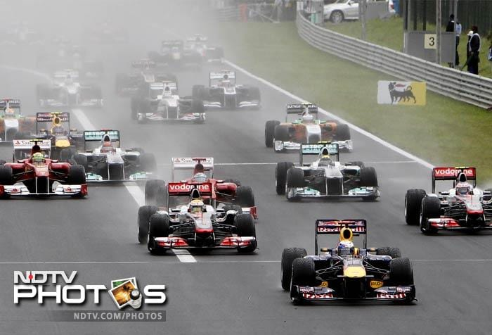 Red Bull driver Sebastian Vettel of Germany led the field after the start of the Hungarian Formula One Grand Prix.