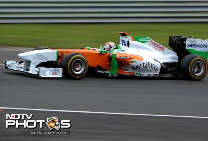 Force India's Paul di Resta races hard as he eventually finished seventh and collected points for his team.