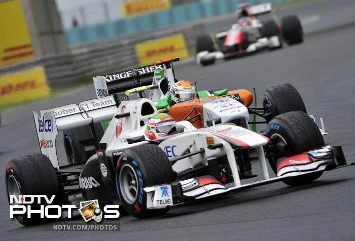 Sauber's Mexican driver Sergio Perez (L) and Force India's German driver Adrian Sutil in action. Perez eventually finished on the 15th position, a place behind Sutil.