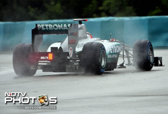 Schumacher slides off the track at the Hungaroring circuit. He had to retire from the race.