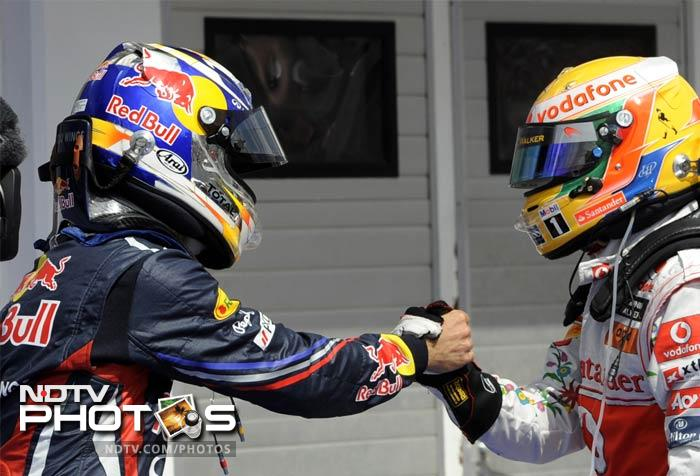 The day however, belonged to Button, left, who is seen here being congratulated by Vettel after the race.