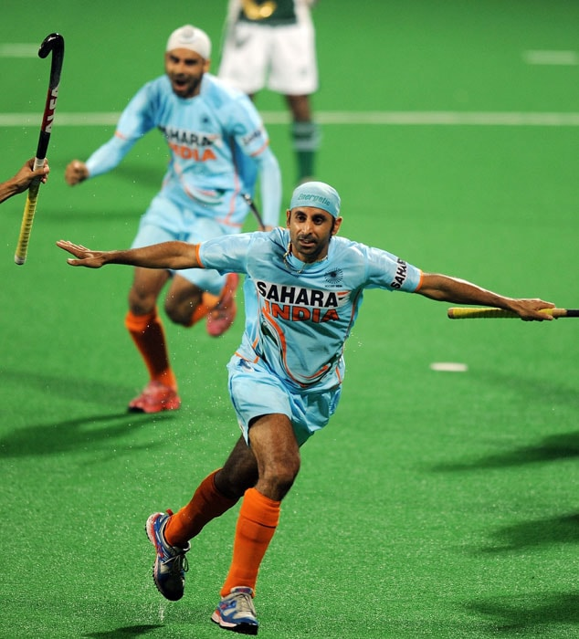 Indian hockey player Prabhjot Singh celebrates scoring a goal against Pakistan during their World Cup 2010 match at the Major Dhyan Chand Stadium in New Delhi on February 28. India beat Pakistan 4-1. (AFP Photo)