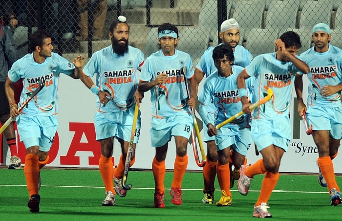 Indian hockey player Shivendra Singh (#18, C) celebrates with teammates after scoring a goal against Pakistan during their World Cup 2010 match at the Major Dhyan Chand Stadium in New Delhi. (AFP Photo)