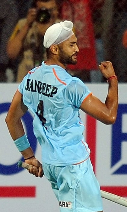 Indian hockey player Sandeep Singh (#4) reacts after scoring a goal against Pakistan during their World Cup 2010 match at the Major Dhyan Chand Stadium in New Delhi on February 28. (AFP Photo)