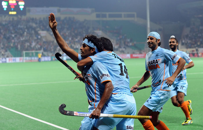 Indian hockey player Shivendra Singh (L) celebrates a goal against Pakistan during their hockey World Cup 2010 match at the Major Dhyan Chand Stadium in New Delhi on February 28. (AFP Photo)