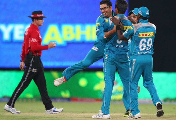 After missing out on IPL last season Yuvraj Singh is back with double energy and enthusiasm. He is seen celebrating the wicket of Parthiv patel taken by Ashok DInda (Unseen) (Image BCCI)