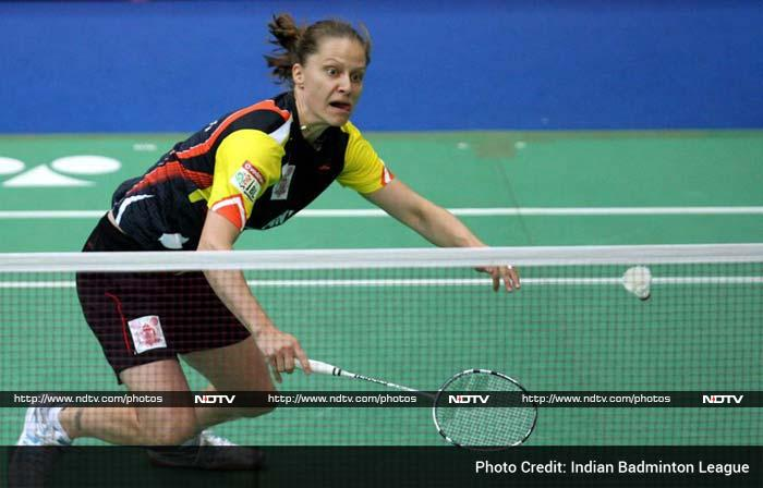 World number three Juliane Schenk put it across Carolina Marin 21-20 21-10 in the women's singles to take Pune to a commanding position.