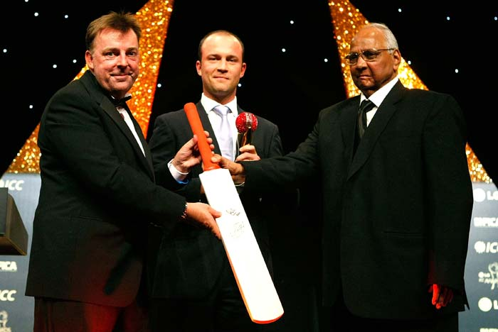 Jonathan Trott (C) of England with the ICC Cricketer of The Year Award poses with ICC President Shawad Pawar (R) and a competition winner. (Photo by Tom Dulat/Getty Images)