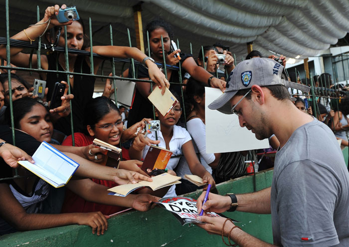 Indian Bollywood actor Neil Nitin Mukesh signs autographs for fans during a cricket match between Indian Bollywood actors and Sri Lankan cricketers during the three-day IIFA awards events in Colombo. (AFP Photo)