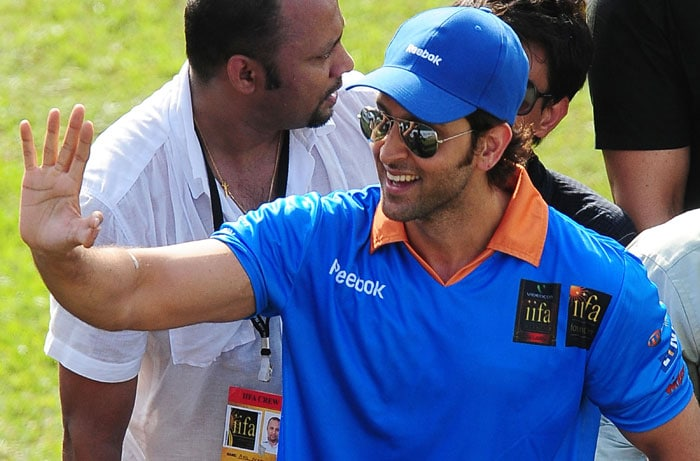 Indian Bollywood actor Hrithik Roshan greets fans during a cricket match between Indian Bollywood actors and Sri Lankan cricketers during the three-day IIFA awards events in Colombo. (AFP Photo)