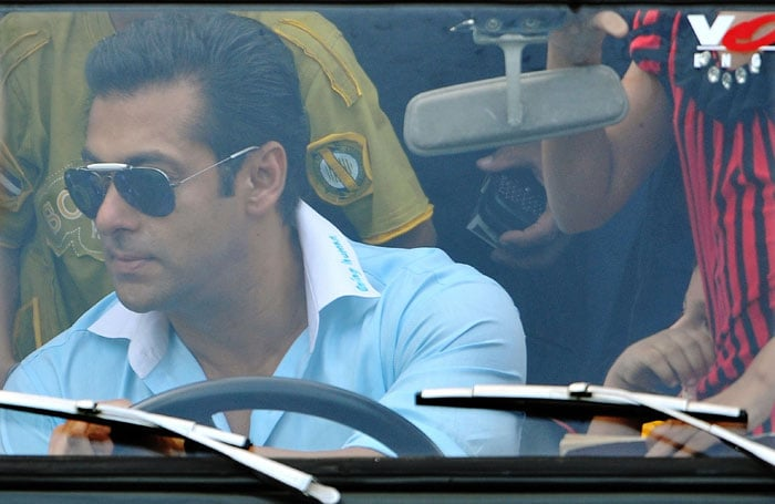 Indian Bollywood actor Salman Khan drives a small car while greeting fans during a cricket match between Indian Bollywood actors and Sri Lankan cricketers during the three-day IIFA awards events in Colombo. (AFP Photo)