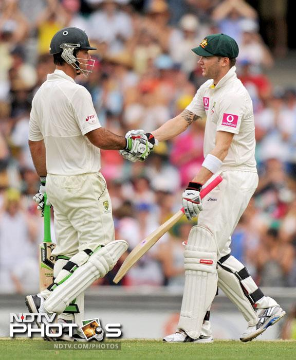 Michael Clarke is congratulated by Ricky Ponting after reaching his 150 on Day 2 of the second Test against India at the Sydney Ground. (AFP Photo)